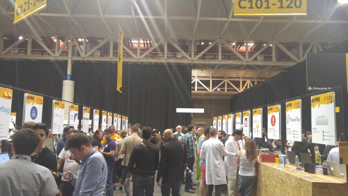 Startups fill two rows of trade show booths